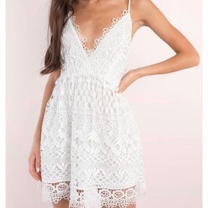 White lace Skater dress with deep v neck.